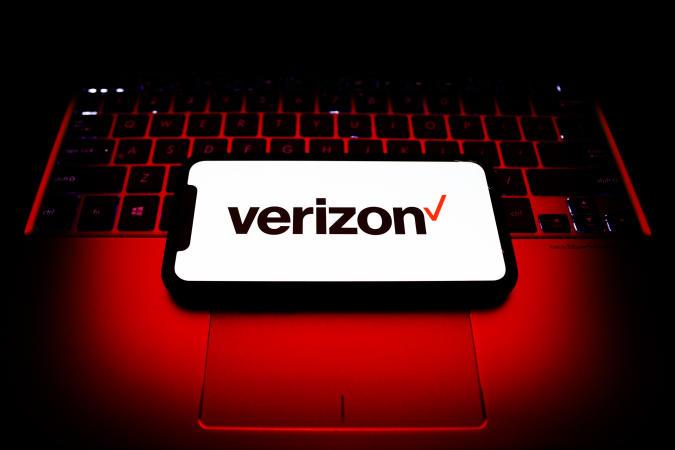 Verizon logo is seen displayed on a phone screen in this illustration photo taken in Poland on November 19, 2020. (Photo by Jakub Porzycki/NurPhoto via Getty Images)
