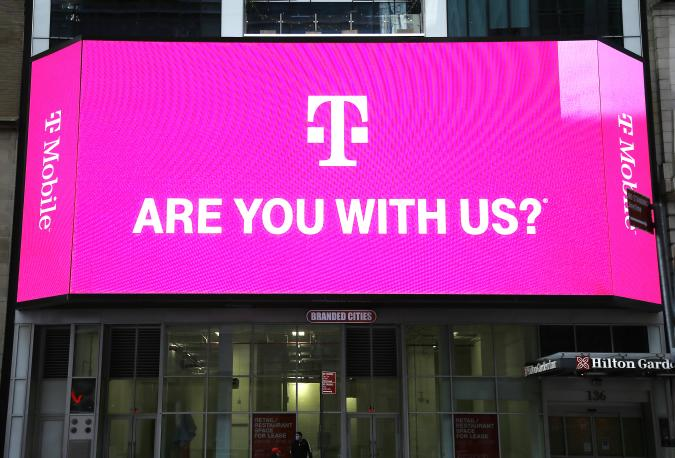 NEW YORK, UNITED STATES - 2020/10/15: T-Mobile network advertises seen on a Jumbotron in Times Square. (Photo by John Lamparski/SOPA Images/LightRocket via Getty Images)