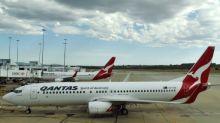 Lower fares hit Qantas first half profit