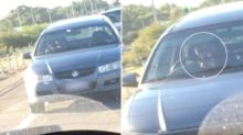 Terrifying video emerges of driver swerving while on phone