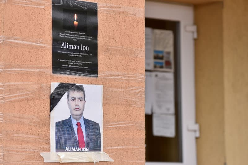 An obituary photo of former mayor Aliman Ion is taped onto the walls of the city hall in Deveselu