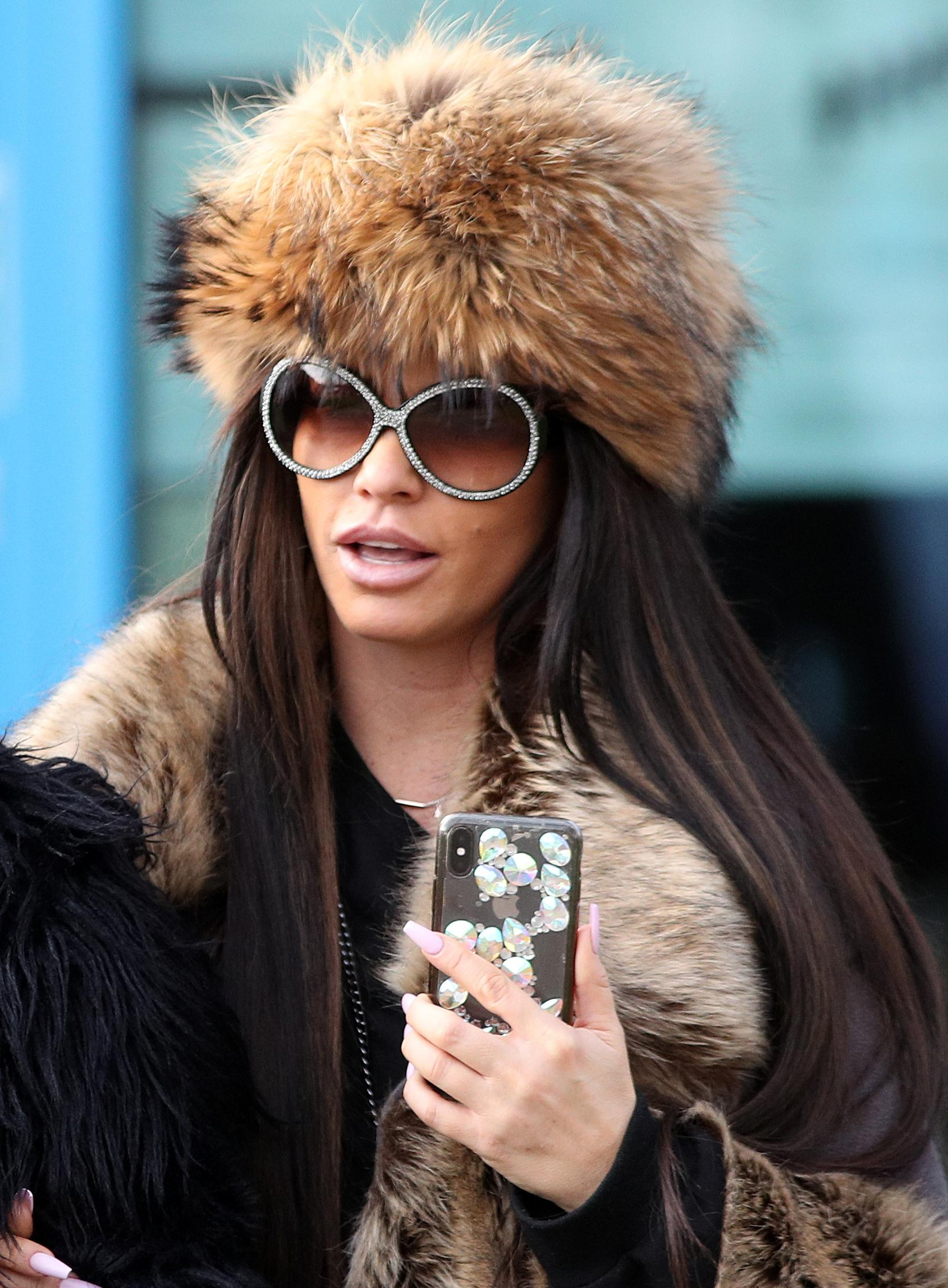 Katie Price leaves Crawley Magistrates' Court after she was banned from driving for three months and fined �1,100 for driving while disqualified and without insurance on the A24 near her home in West Sussex on July 25.