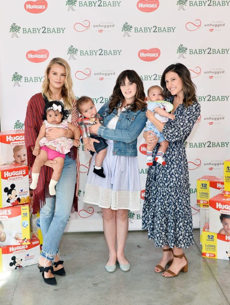 Zooey Deschanel with Baby2Baby'sKellySawyer andNorahWeinstein at the event. Again, not her baby.