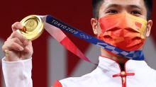Olympics-Weightlifting-Li's 'flamingo' amuses audience