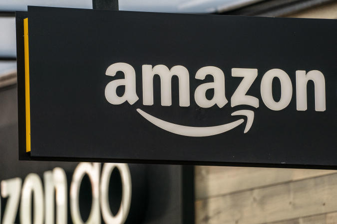 SEATTLE, WA - MAY 20: A sign is seen outside of an Amazon Go store at the Amazon.com Inc. headquarters on May 20, 2021 in Seattle, Washington. Five women employees sued Amazon this week, alleging discrimination and retaliation. (Photo by David Ryder/Getty Images)