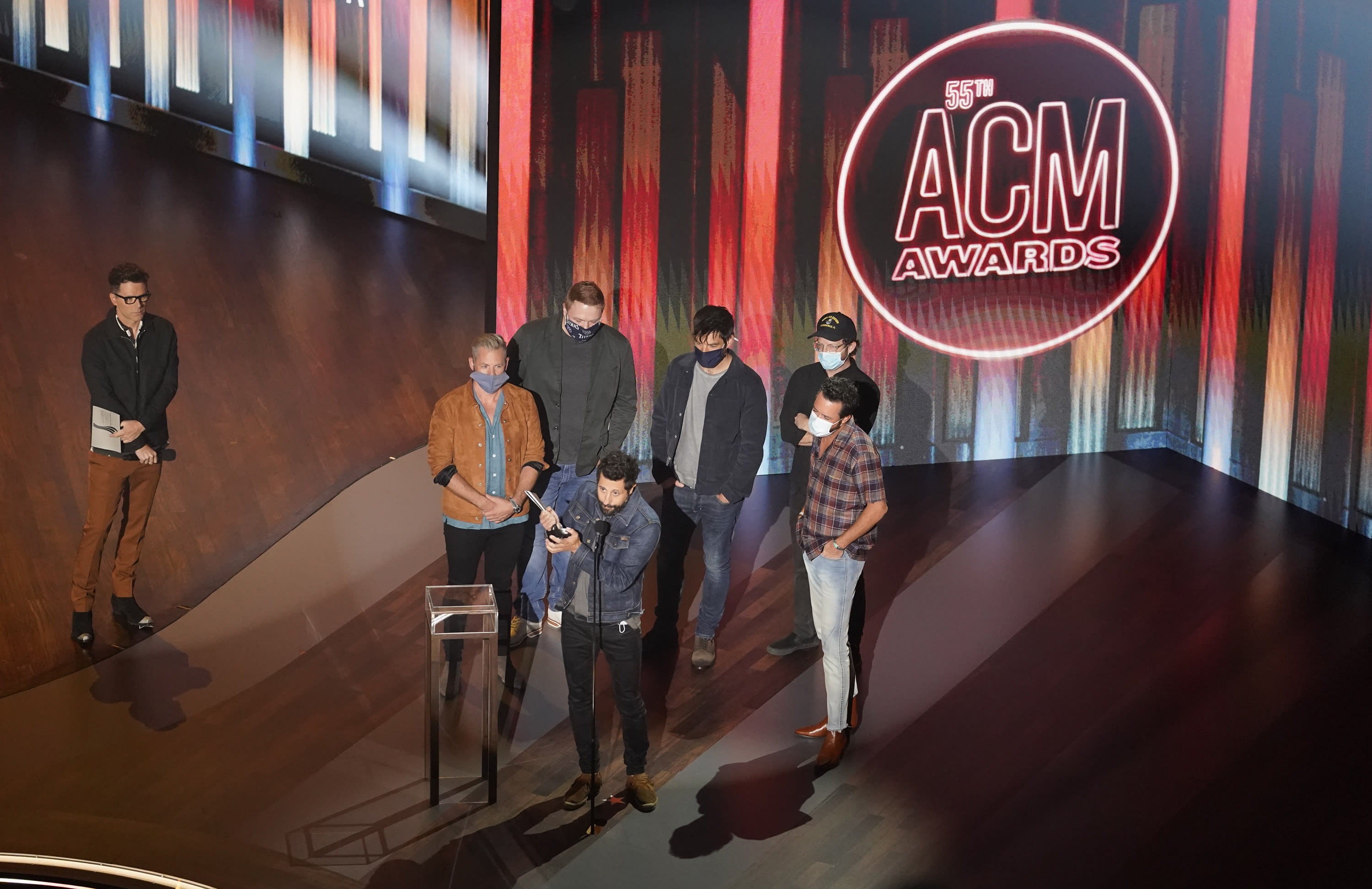 """Old Dominion accepts the song of the year award for """"One Man Band"""" as presenter Bobby Bones, left, looks on during the 55th annual Academy of Country Music Awards at the Grand Ole Opry House on Wednesday, Sept. 16, 2020, in Nashville, Tenn. (AP Photo/Mark Humphrey)"""