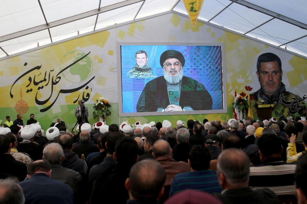 Supporters of Lebanon's militant Shiite movement Hezbollah watch a televised speech by Hassan Nasrallah, the head of Hezbollah, in the southern town of Insar, in the Nabatiyeh district on March 6, 2016