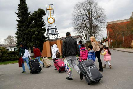 Syrian refugees arrive at the camp for refugees and migrants in Friedland