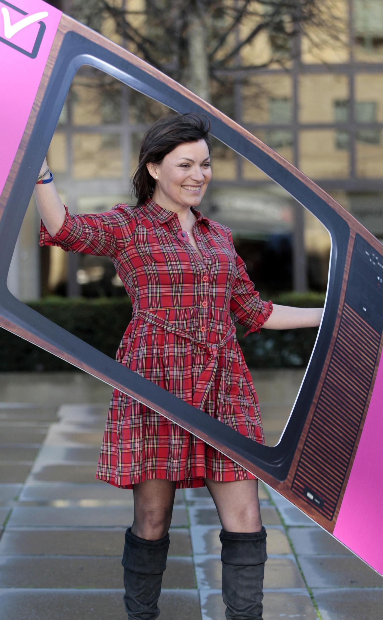 Lorraine Kelly poses in a cutout of a television screen, in Edinburgh, to mark the start of the six month countdown to the digital switchover for viewers in central Scotland.