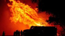At least eight dead as California inferno surges north into Oregon