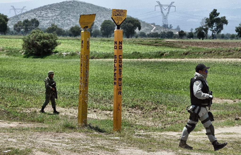 Signs mark the location of underground PEMEX fuel pipes. Soldiers have engaged Tepeaca thieves in deadly gun battles when they catch them tapping into the pipes to siphon fuel (AFP Photo/ALFREDO ESTRELLA)
