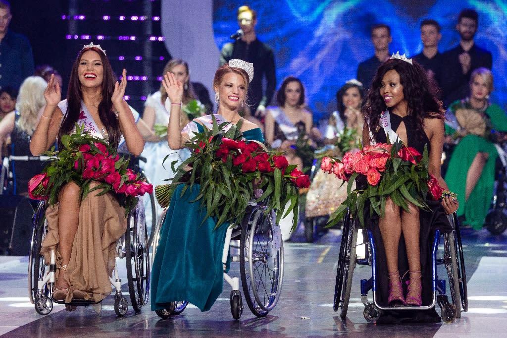 Miss Belarus Aleksandra Chichikova (C), winner of the Miss Wheelchair World beauty pageant, first runner-up Lebohang Monyatsi from South Africa (R) and second runner-up Adriana Zawadzinska of Poland at the awards held in Warsaw. (AFP Photo/Wojtek Radwanski)