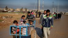 Families fleeing Mosul warzone drugging children to avoid execution by Isis aid agencies say