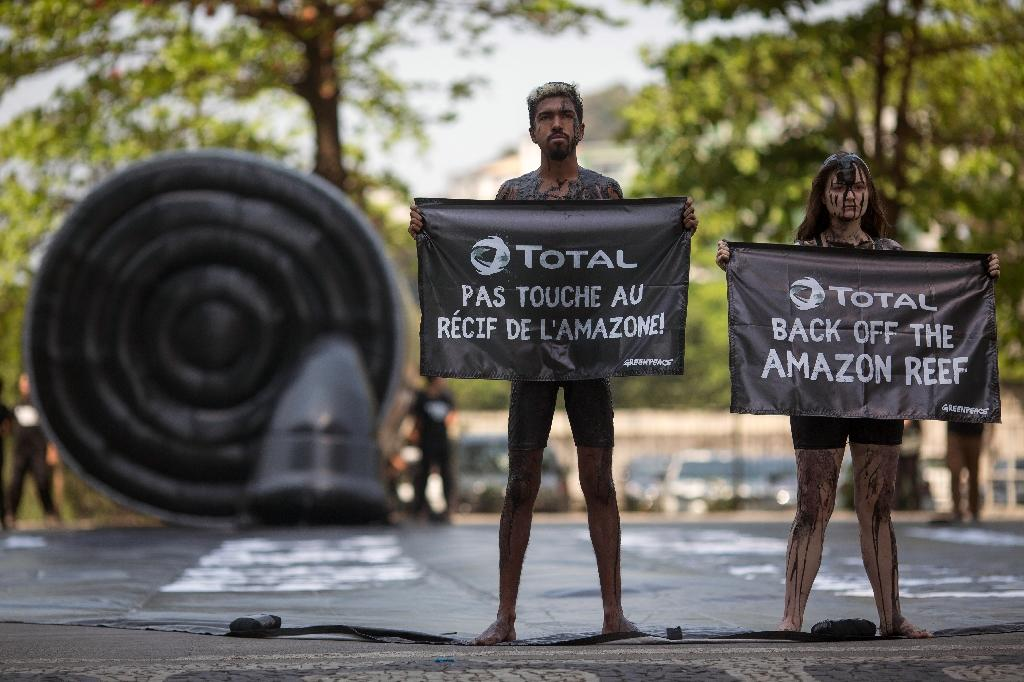 Greenpeace activists stage a protest in Rio de Janeiro against Total's planned oil exploration near a huge coral reef off the coast of Brazil