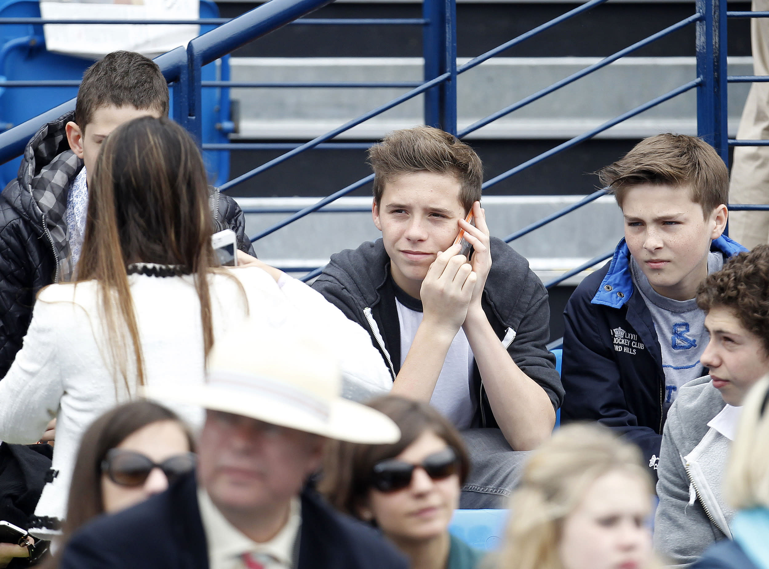 Tennis - AEGON Championships - Queens Club, London - 16/6/13  Men's Singles - Son of former footballer David Beckham (not pictured), Brooklyn Beckham (C) watches from the stands before the final  Mandatory Credit: Action Images / Jed Leicester  Livepic