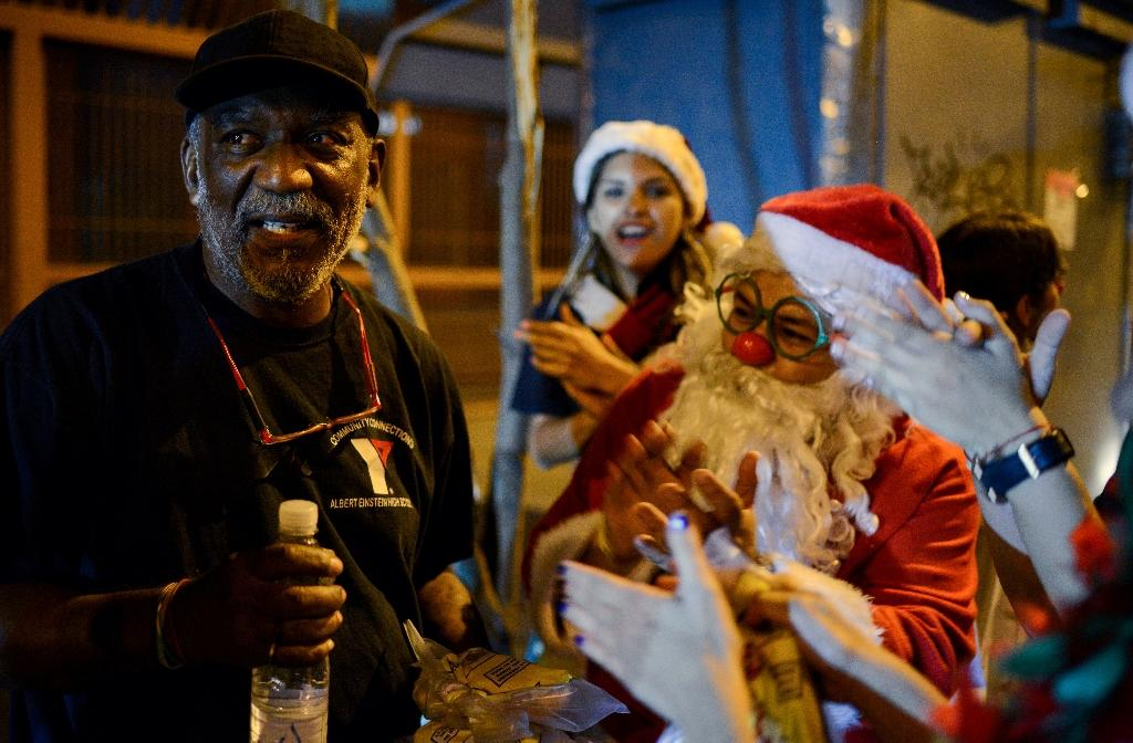 The 12-year-old program called 'Santa in the Streets' now has more than 1,300 volunteers (AFP Photo/FEDERICO PARRA)