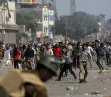 Five killed, 90 hurt in violence in Indian capital - hospital official