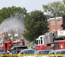 Gas explosion destroys Baltimore homes; one dead as firefighters search for victims