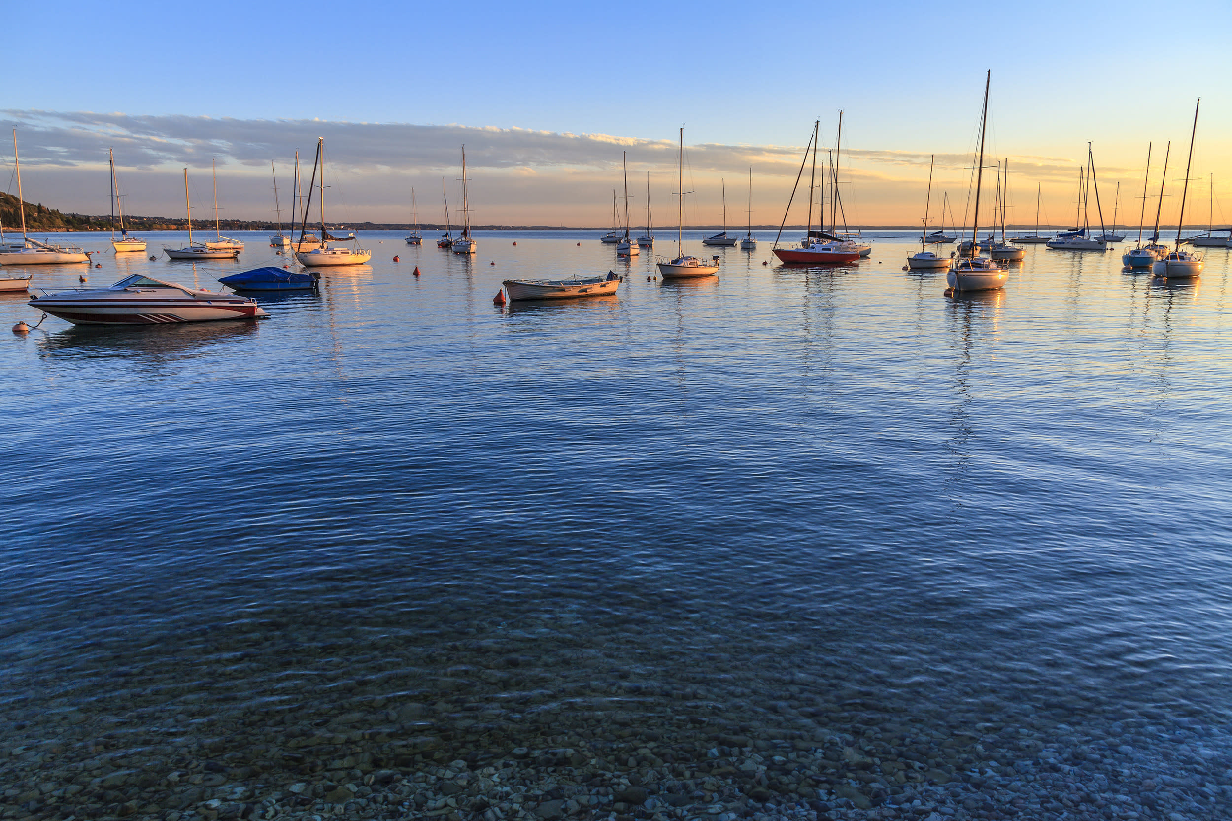 """<span style=""""font-family:helvetica, arial;font-size:16px;background-color:rgb(255, 255, 255);"""">A honeymoon on Lake Garda will remind you why you fell in love to begin with. Italy's largest lake remains an unspoilt haven of peace for honeymooners. On the shores of the lake you will find several charming villages. On the northwestern side of the lake, and well worth a visit is Limone, with its cobbled streets, nestled among the lemon groves. A swim in the clear and warm water of Lake Garda is a must, especially in the summer. Surrounded by cypresses, vines, orange trees and citrus groves, Lake Garda is the essence of Italian romance.</span>"""