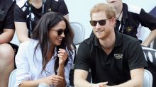 Meghan Markle and Prince Harry hold hands during first official appearance together