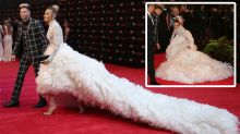 AFL WAG turns heads in OTT feather dress on Brownlow red carpet