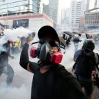 Hong Kong protesters hurl petrol bombs at government buildings in latest wave of unrest