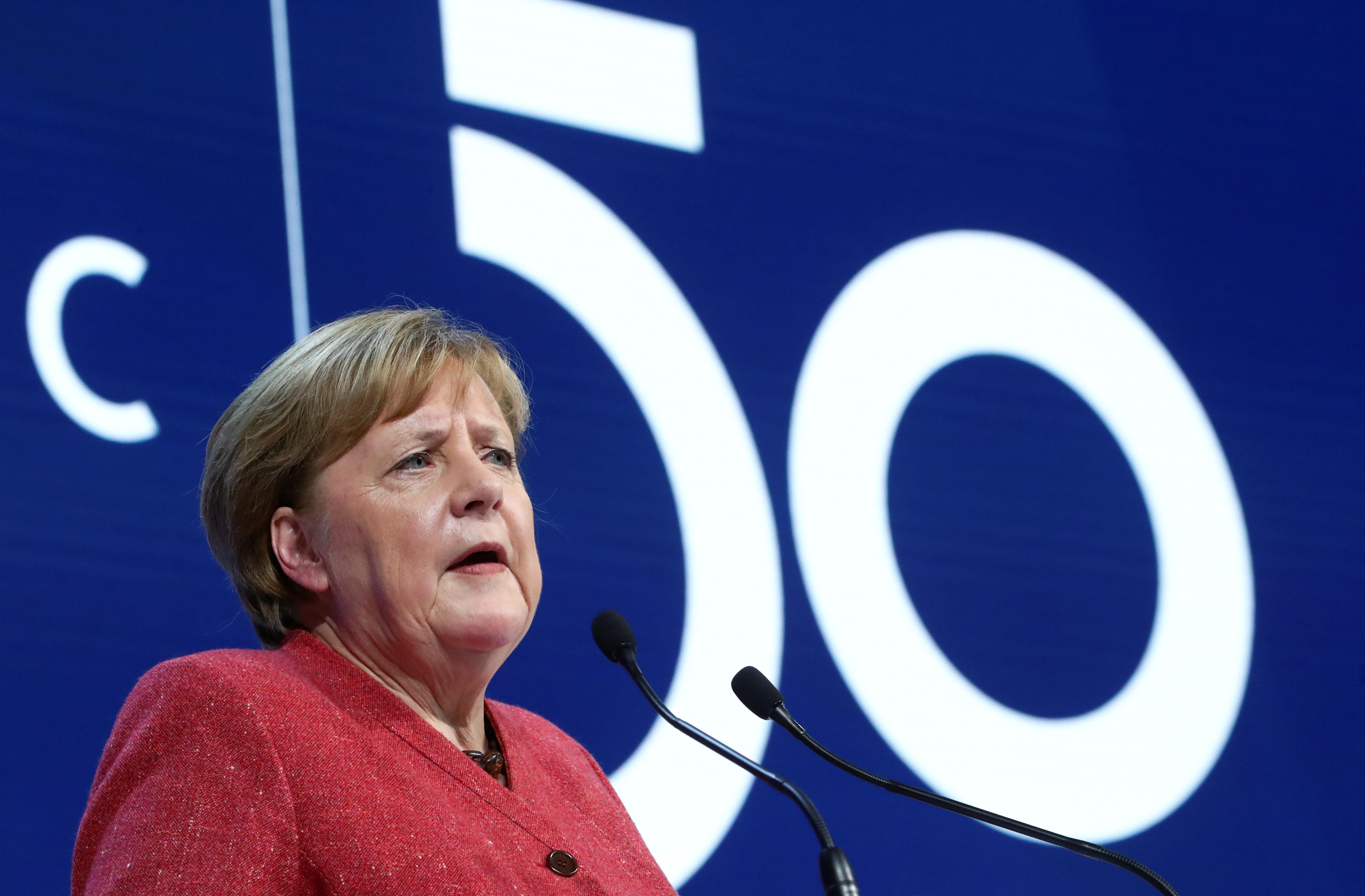 Our survival hinges on achieving Paris climate goals, Merkel tells Davos leaders