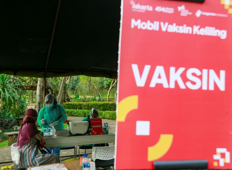 Indonesia sends out vaccination vans to speed up rollout