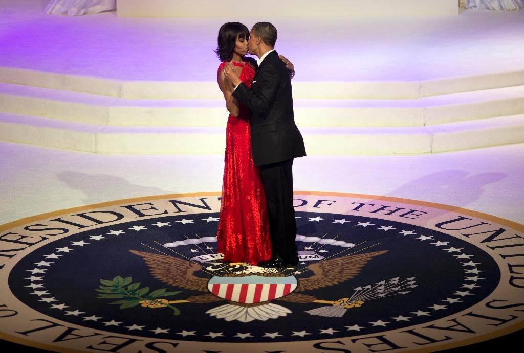 US President Barack Obama and First Lady Michelle Obama kiss while dancing at the Commander and Chief Ball in 2013 in Washington, DC (AFP Photo/BRENDAN SMIALOWSKI)