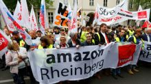 Protesters greet Amazon's Jeff Bezos in Germany