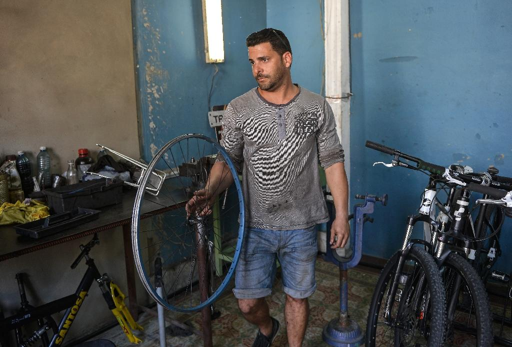 Asley Alfonso Gil works at his private bicycle repairing business in Cienfuegos province, Cuba (AFP Photo/Yamil LAGE)