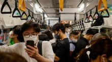 Virus cases surge in Tokyo as government expands restrictions