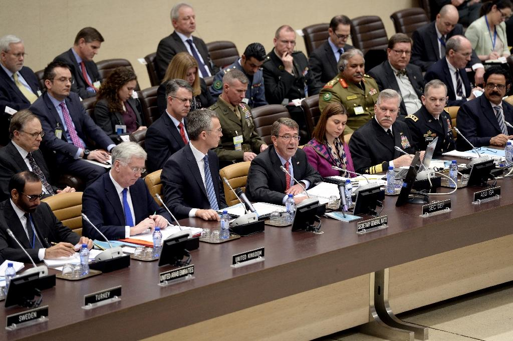 US Secretary of Defence Ashton Carter (C) speaks as NATO Secretary General Jens Stoltenberg (3-L) looks on during the Global Coalition meeting against the Islamic State group, held at NATO headquarter in Brussels on February 11, 2016