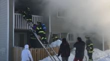 No 'apparent injuries' for woman rescued from balcony during weekend house fire