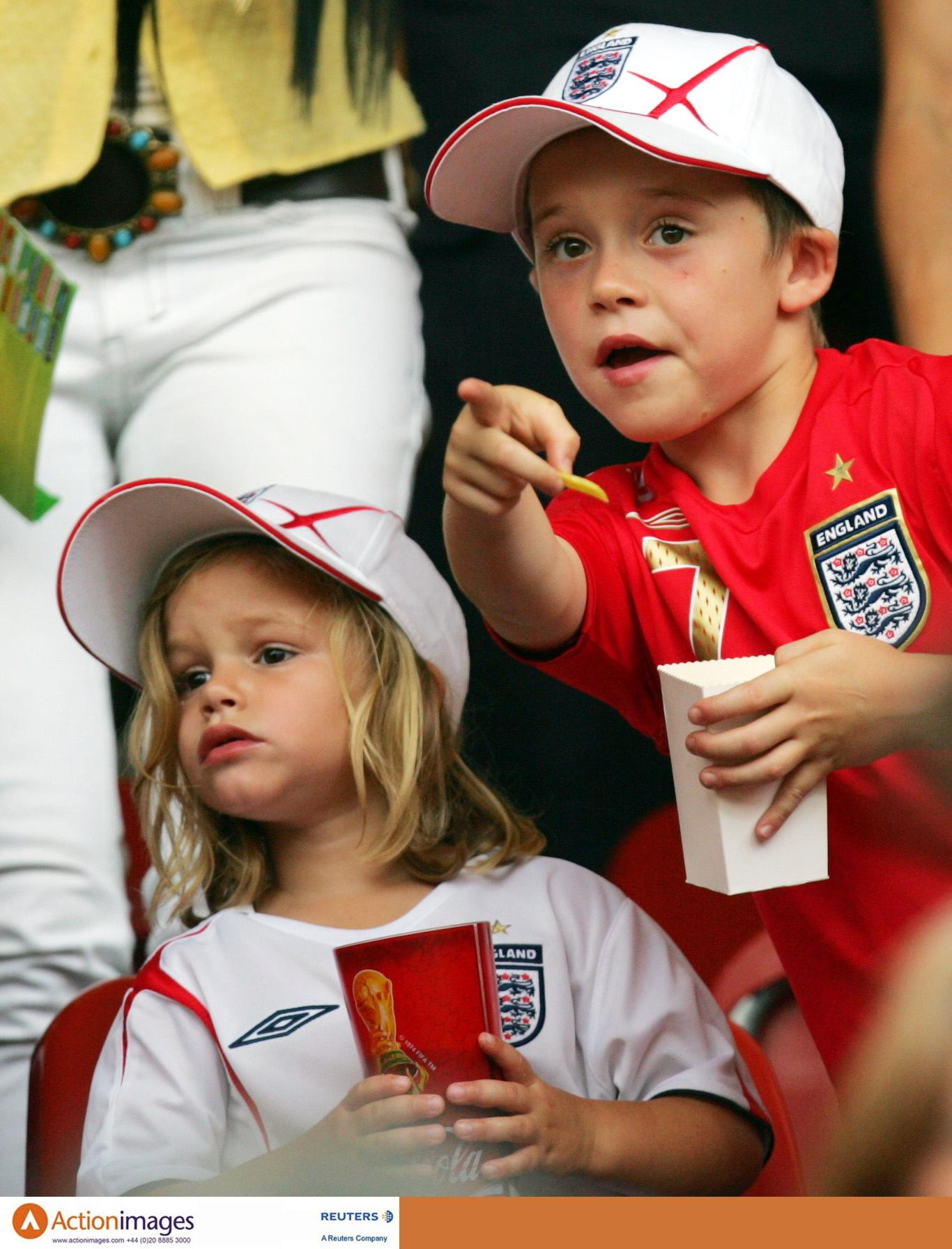 Football - England v Trinidad & Tobago 2006 FIFA World Cup Germany - Group B  - Frankenstadion, Nuremberg  - 15/6/06  England's David Beckham's kids in the crowd. Romeo (left) and Brooklyn (right0  Mandatory Credit: Action Images / Michael Regan  Livepic