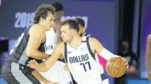 Doncic triple gets Mavs off mark as Clippers, Bucks fall