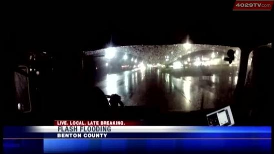 Firefighters pull people to safety after cars left stranded on flooded roads