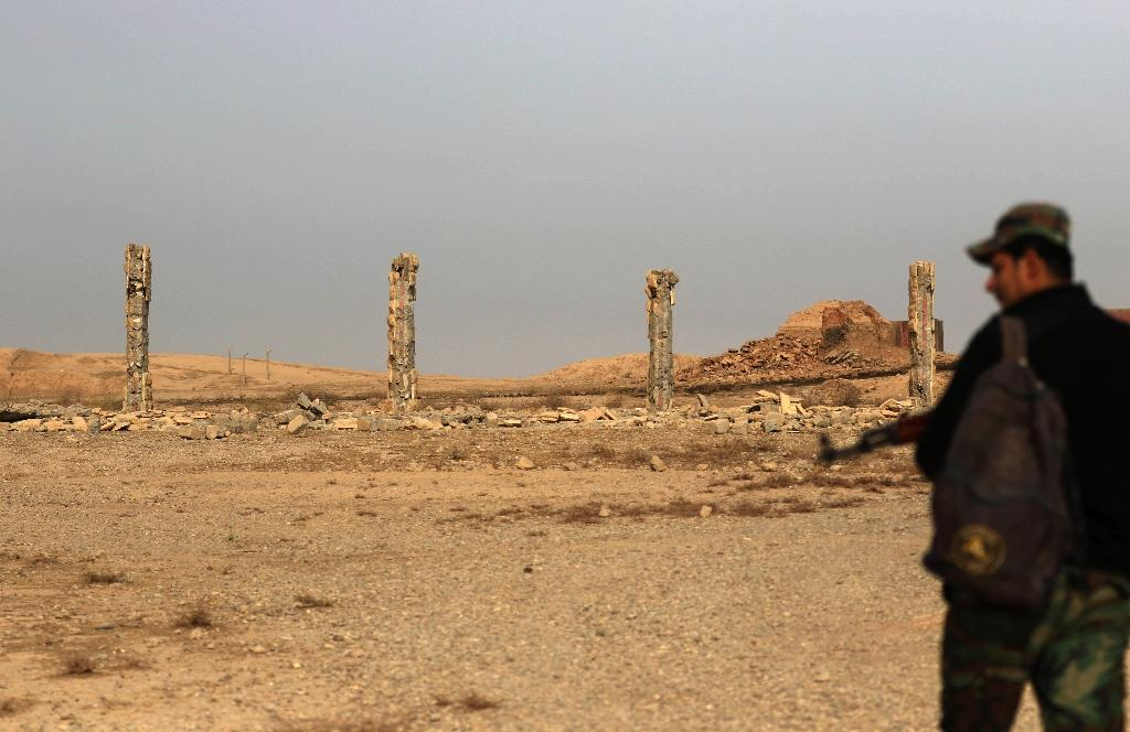 An Iraqi soldier looks at destruction caused by the Islamic State (IS) group at the archaeological site of Nimrud, 30 kilometres south of Mosul, on November 15, 2016, a few days after Iraqi forces retook the ancient city from IS jihadists