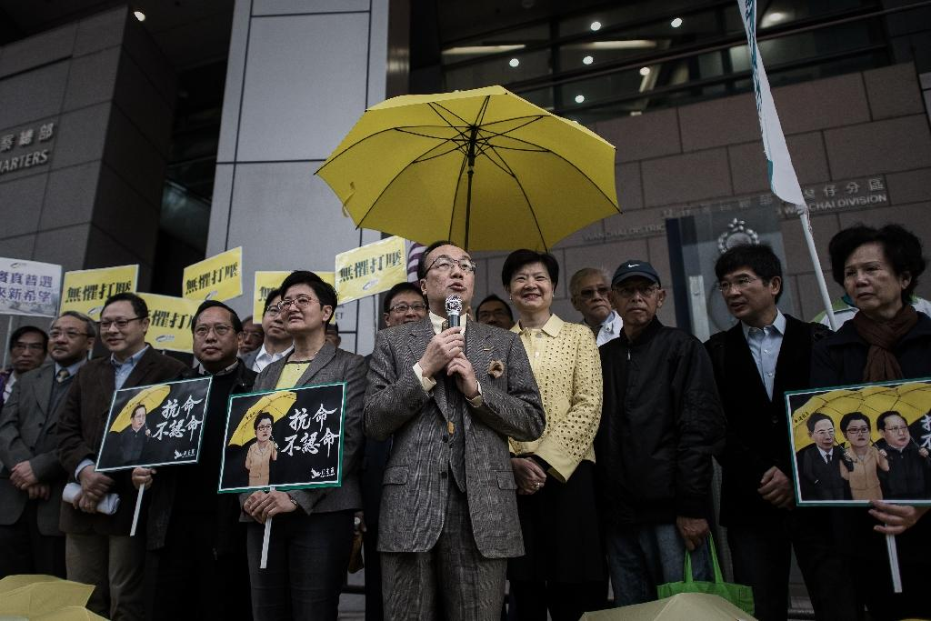 Pro-democracy legislator Alan Leong talks to the media outside the Wanchai police station in Hong Kong, on March 2, 2015 (AFP Photo/Philippe Lopez)