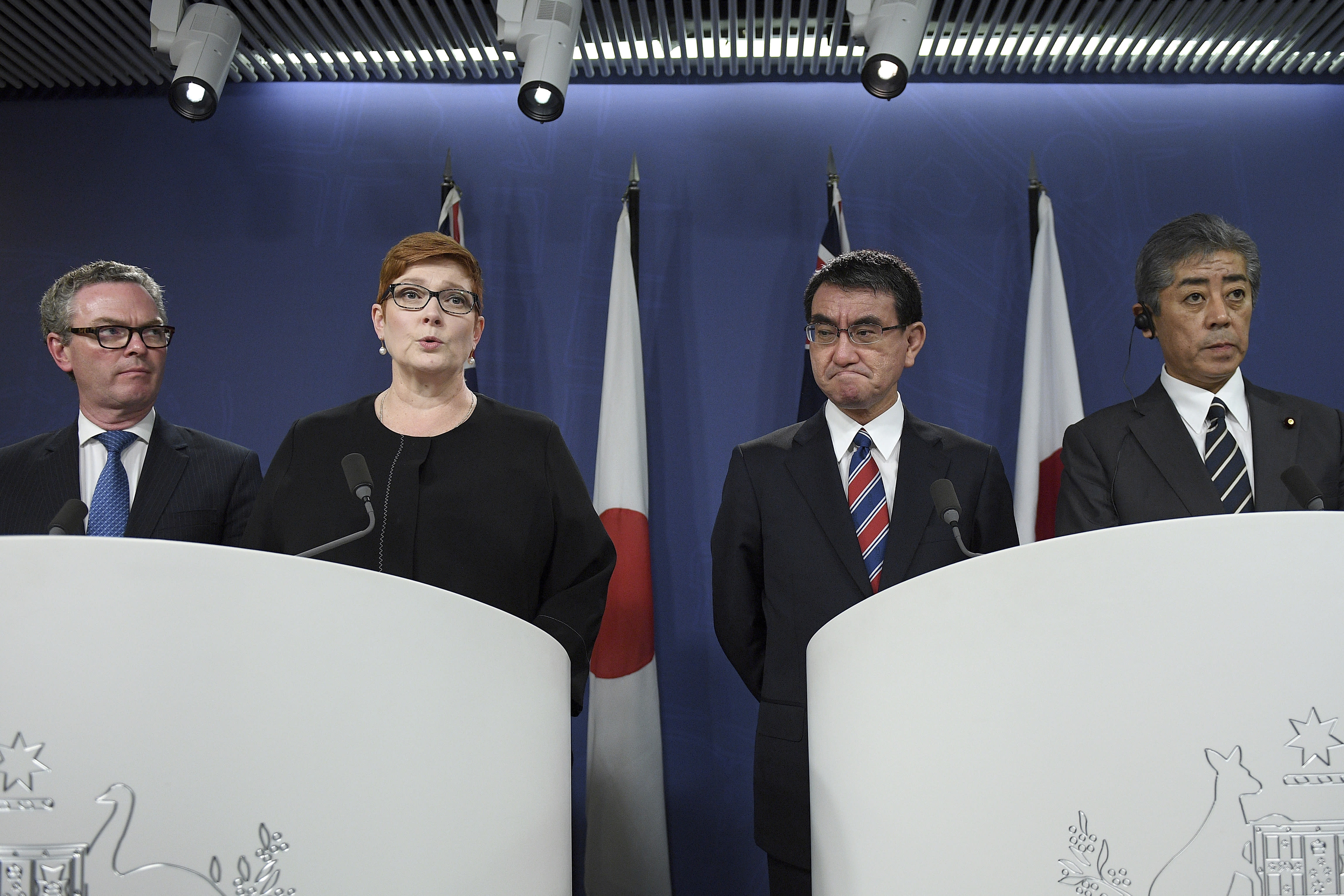 Australian Foreign Minister Marise Payne, second from left, speaks as Australian Defense Minister Christopher Pyne, left, Japanese Foreign Minister Taro Kono, second from right, and Japanese Defense Minister Takeshi Iwaya listen during a joint press conference in Sydney, Wednesday, Oct. 10, 2018. Australia and Japan on Wednesday reaffirmed their commitment to pressuring North Korea to abandon its nuclear weapons program and enforcing sanctions on Pyongyang. (Dan Himbrechts/AAP Images via AP)