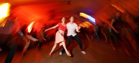 """Swing dance teachers perform at """"Claerchens Ballhaus"""" in Berlin, Germany, August 31, 2016. Claerchens Ballhaus first opened over 100 years ago, and for some 90 years it was run by the same family. Much of the decor still has an antique, untouched look. REUTERS/Hannibal Hanschke"""