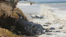 Couple forced to abandon ute as cyclonic waves and king tides combine