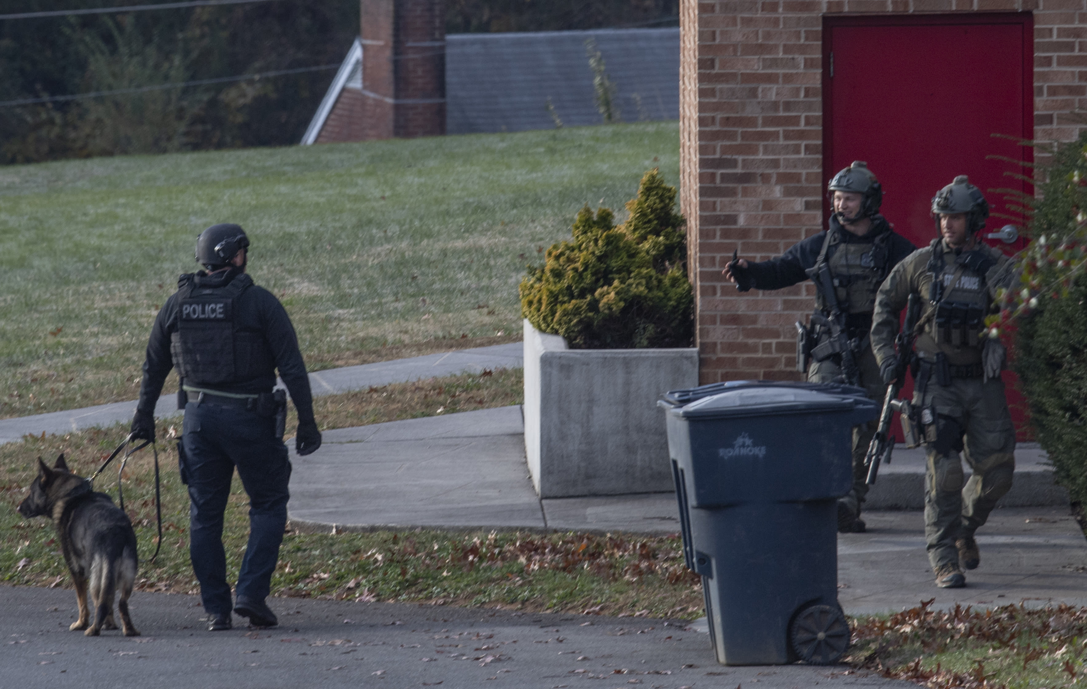 Police search a local church for a Marine deserter who is wanted for questioning in a murder case, in Roanoke, Va., Thursday, Nov. 14, 2019. (AP Photo/Don Petersen)