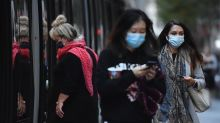 Sydneysiders mask up as virus link sought