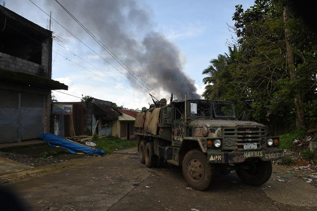 The militants, initially estimated to number just 100, have withstood eight days of intense air assaults and street-to-street combat, prompting the Philippine government to call on them to surrender (AFP Photo/TED ALJIBE)