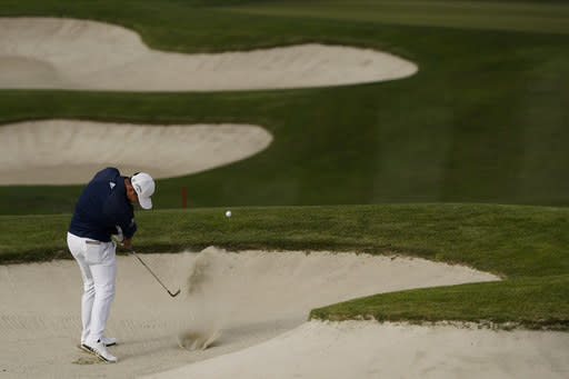 Daniel Berger hits from the bunker on the 18th hole during the second round of the PGA Championship golf tournament at TPC Harding Park Friday, Aug. 7, 2020, in San Francisco. (AP Photo/Charlie Riedel)
