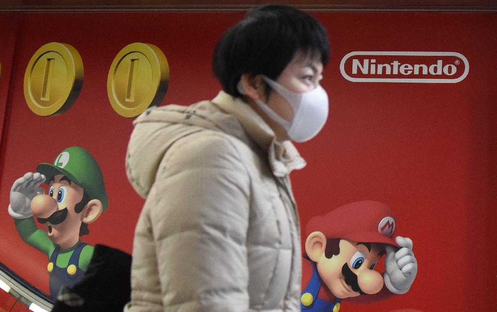 Nintendo jumped 3,310 yen to 19,580 yen as its latest foray into mobile gaming launched in the US and Australia was an immediate hit