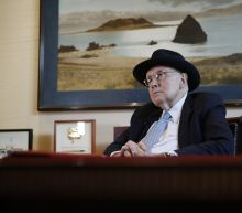 The Latest: Former Sen. Reid calls for end of caucuses
