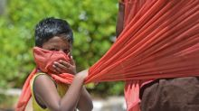 India records almost 25,000 new coronavirus cases as South African health officials prepare 1.5 million graves
