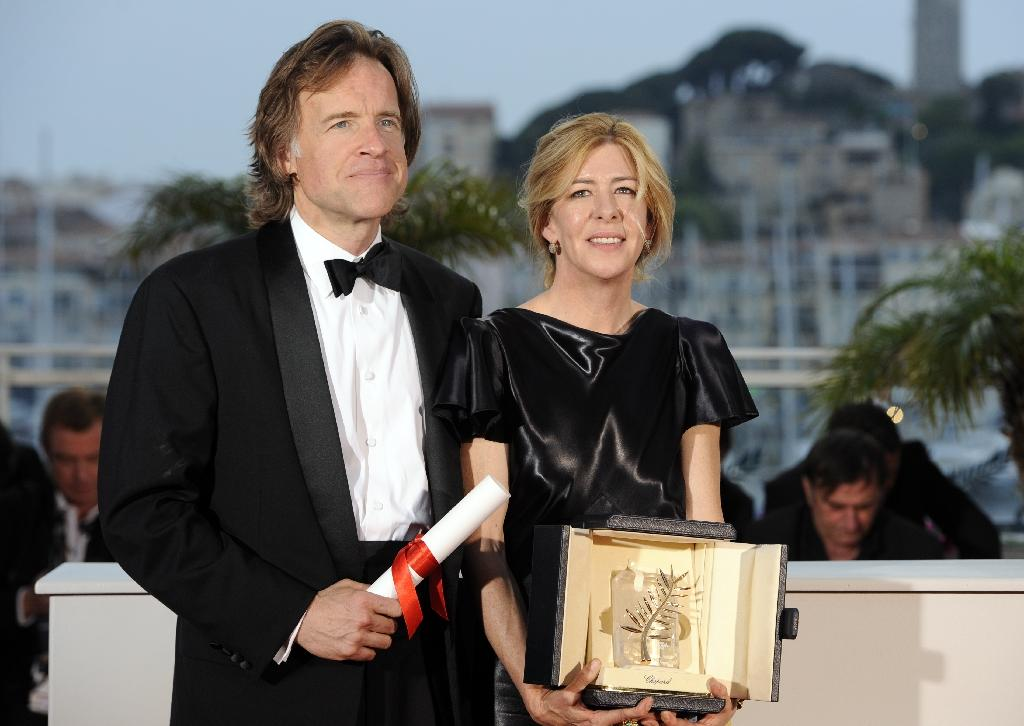 "US director Terrence Malick won Cannes festival's Palme D'Or in 2011 for ""The tree of Life"". Producers Bill Pohlad and Dede Gardner receiving the prize on his behalf (AFP Photo/Anne-Christine Poujoulat)"